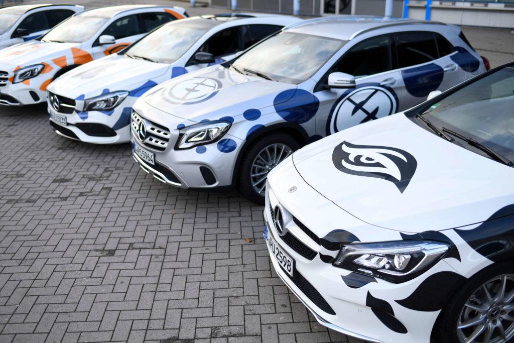 Fahrzeugbeschriftung auf ESL-One Teamcars.